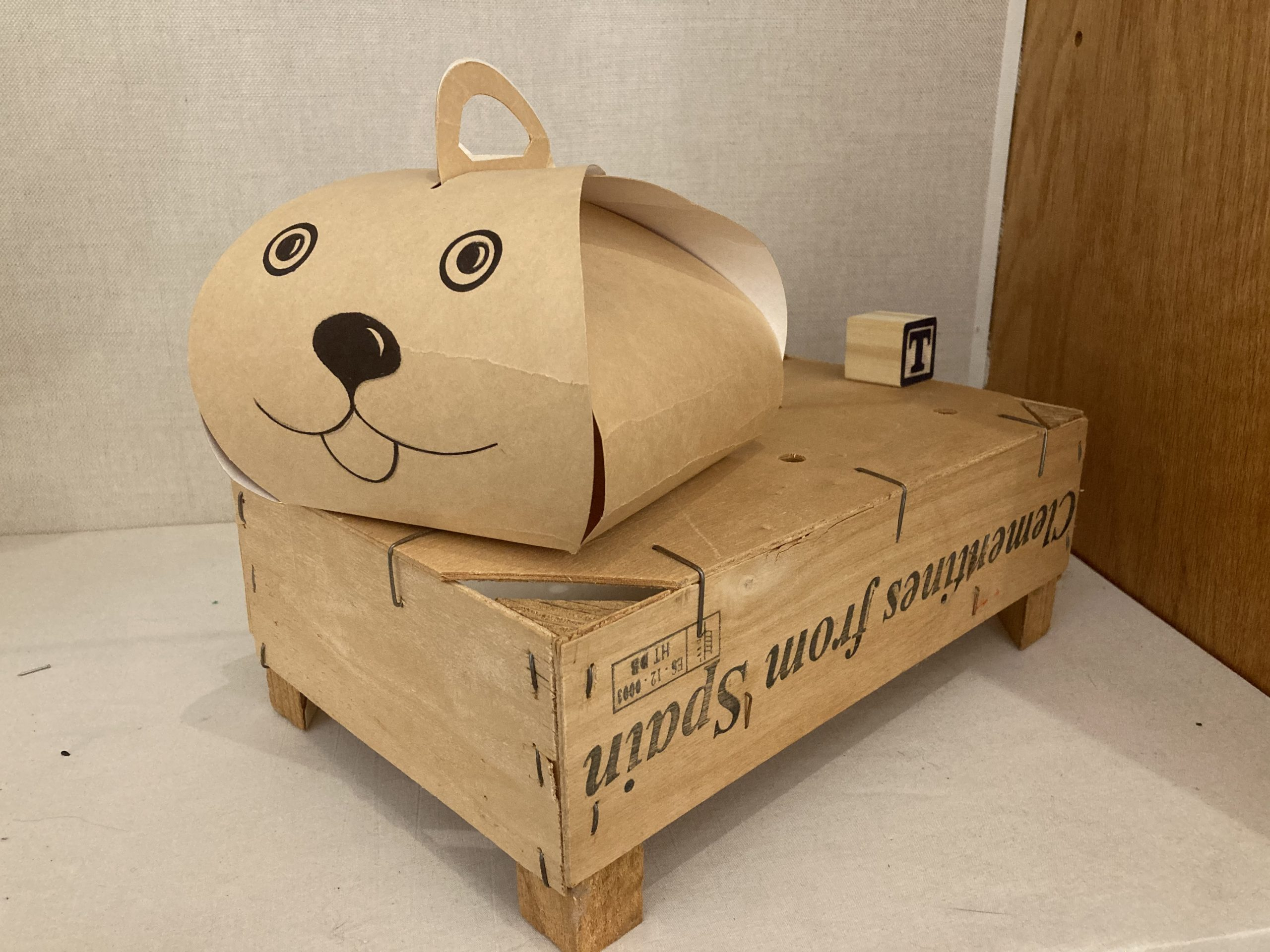 "Mark Luiggi  -  Dog  -  pastry carrier, alphabet block, clementine box  -  10"" x 12"" x 7.5'  -  $50.00"