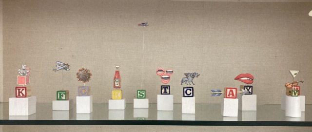 Mark Luiggi's Alphabet Sculptures  -  Range – 2 x 2 x 3 to 2 x 2 x 12  Left to right – King, Flight, COVID-19, Ketchup, Superman, Trio, Cerberus, Arrow,   X-Rated, Violin, Martini