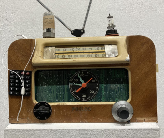 Robert Goss  -  Radio Activity  -  mixed media on old radio  -  10 x 13 x 7  -  $600.00