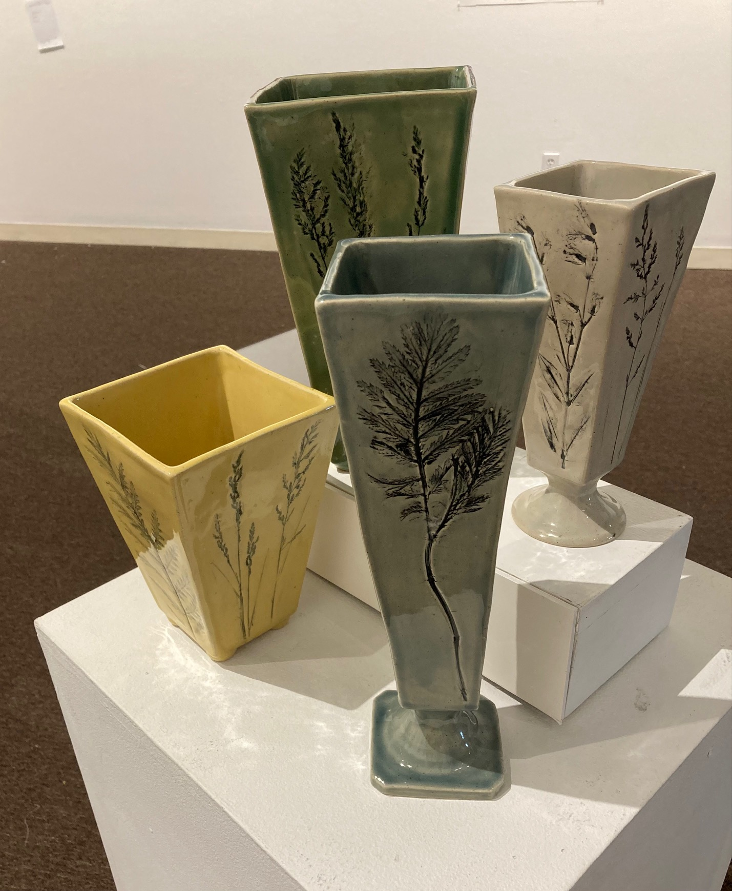 Daniela DesLauriers       Brickbottom Meadows  -  Impressions of the Flora that Surrounds Us  -  4 vases. stoneware  -  $110.00 each